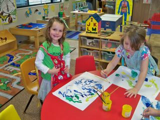 Students painting at at preschool