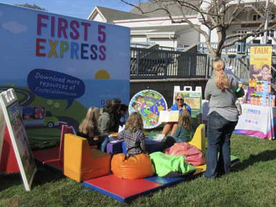 Children listen to a story at First 5 Express