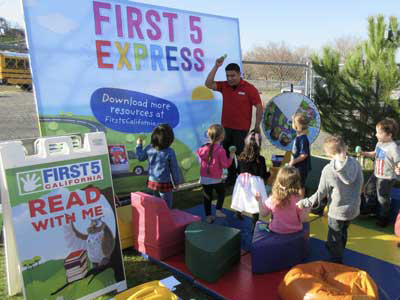 Children play games at First 5 Express