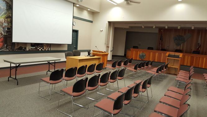 Photograph of chairs Facing projection screen in Government Center
